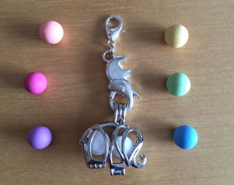 Elephant diffuser locket with elephant clasp and 2 aroma beads.
