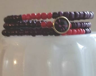 Purple and red beaded memory wire cuff bracelet with purple and gold recycled crystal charm. Free shipping.