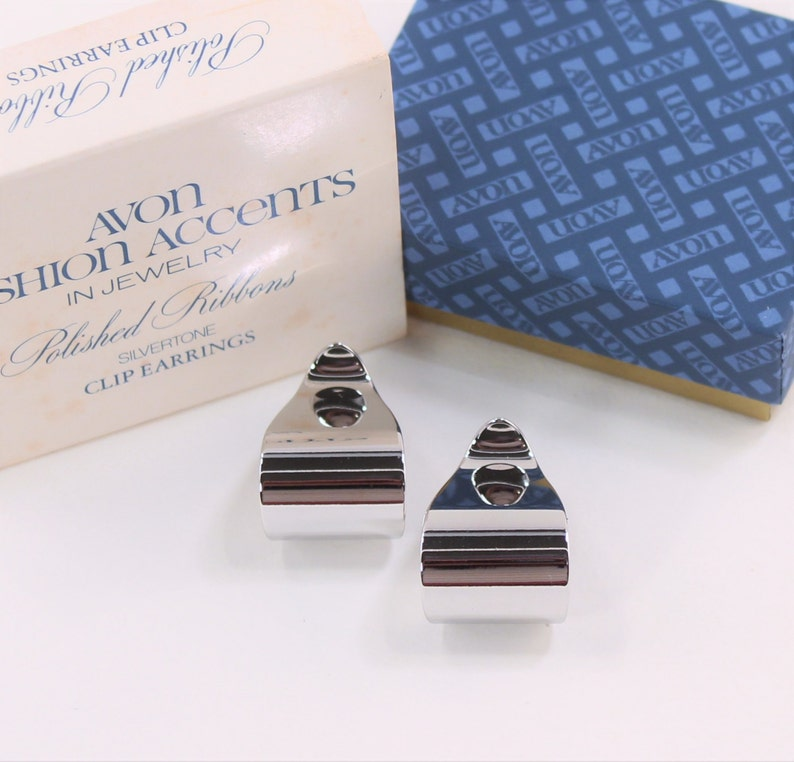Vintage 1977 Signed Avon Polished Ribbons Silver Tone Curled Modern Minimalist Hoops Clip On Earrings in Original Box NIB