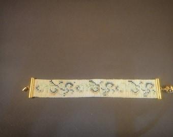 Loom beaded green white and gold bracelet
