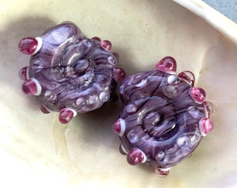 Large sparkling purple green and gold glass ammonite lampwork pendant