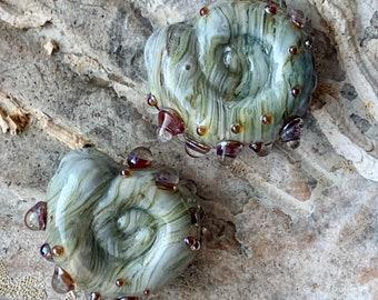 Streaky grey ammonite lampwork bead pair