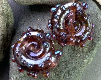 Shiny amethyst ammonite lampwork bead pair