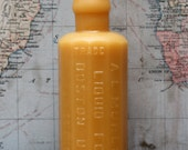 """beeswax Candles - antique bottle shaped - """"LIQUID FOOD"""" - by Pollen Arts - Md."""
