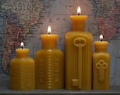 """Beeswax Candle Collection - antique bottle-shaped - """"Locked-In Lovers - Two Keys & Two Poison"""" - by Pollen Arts -"""