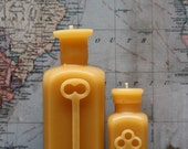 """Beeswax Candle  Set - antique bottle shaped - """"TWO KEYS"""" - by Pollen Arts - Md & Sm."""