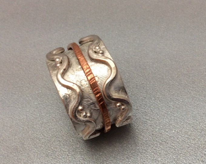 Sterling silver spinner ring with hammered copper spinner