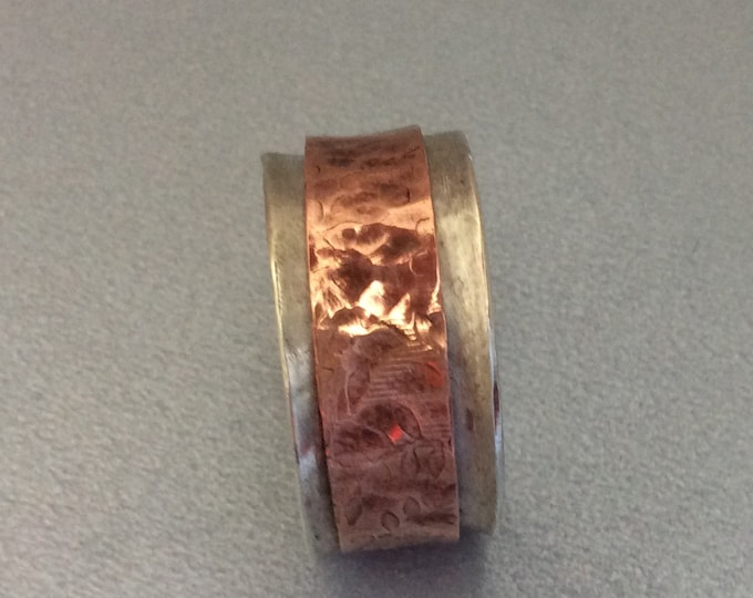 Sterling silver spinner ring with copper spinner