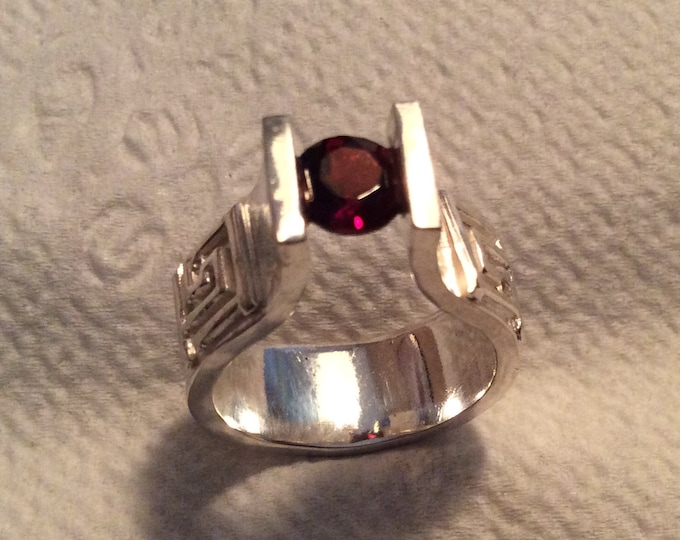 Sterling silver and garnet tension set ring