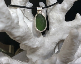 Sterling silver bezel set green seaglass surfer pendant