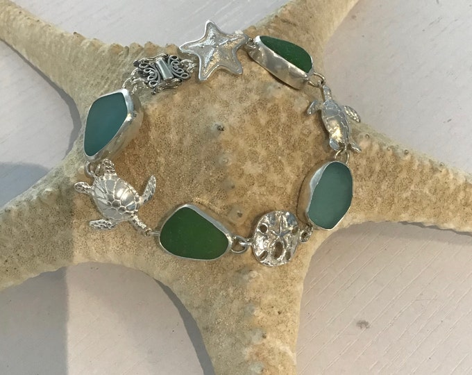 Seaglass Sterling silver bracelet with sterling sea life charms