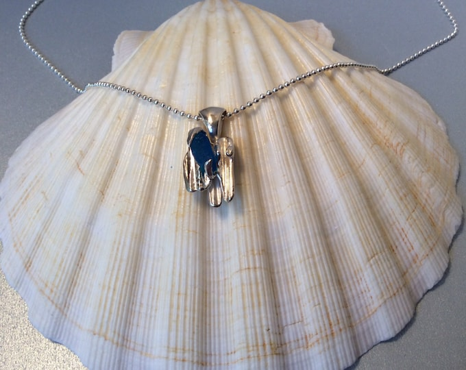 Sterling silver and bright blue seaglass cast pendant