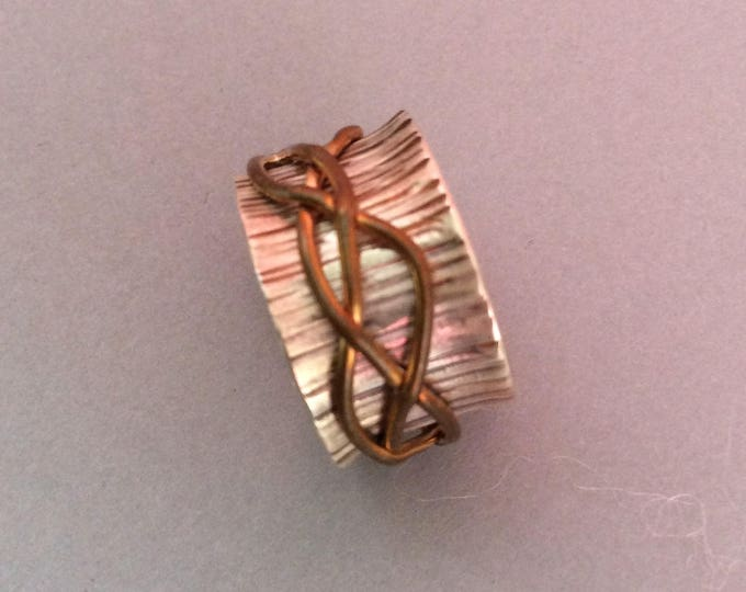 Sterling silver spinner ring with brass freeform spinner