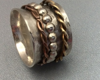 Sterling silver spinner ring with brass and copper spinners