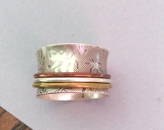 Sterling silver spinner ring with brass, copper, and silver spinners