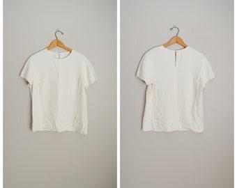cee400bb90f27 ivory flutter SILK blouse 90s short sleeve minimal basic top -- womens  medium petite. PerennialVintageShop