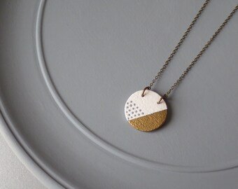 Tal - Cream and Gold Ceramic Pendant Necklace; Handmade Round Clay, Brass Metallic Stripe & Grey Dots (Sautoir Céramique Or) by InfinEight