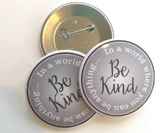 """in a world where you can be anything, be kind button 