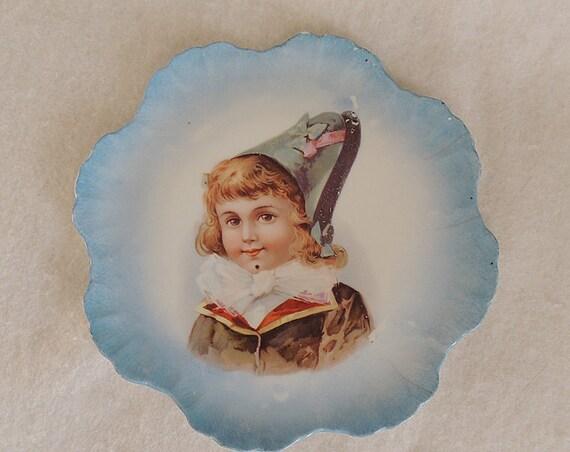Antique Porcelain Portrait Plate.. Sweet Boy With Bow & Fancy Hat