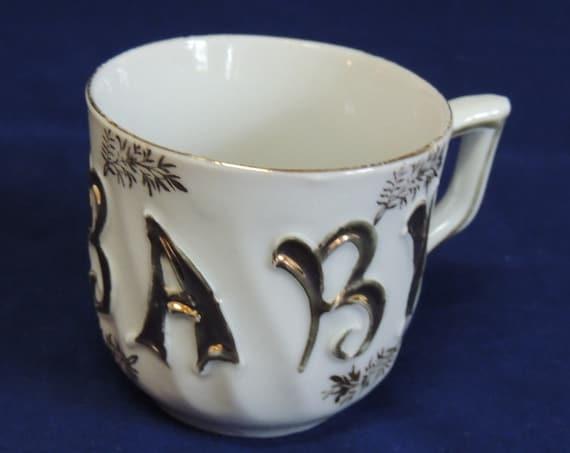 Antique Baby Cup Christening Mug.. Embossed Gold Gilt Porcelain.. Germany