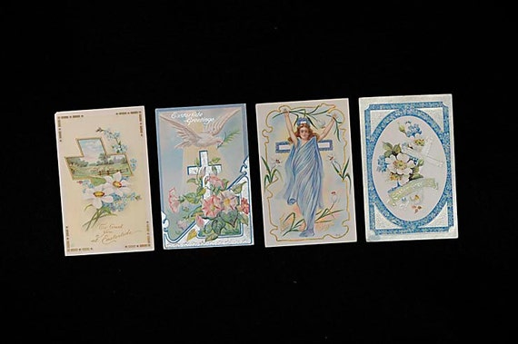 4 Vintage 1900s EMBOSSED EASTER POSTCARDS.. Blues & Pinks Woman Sheep Dove Cross