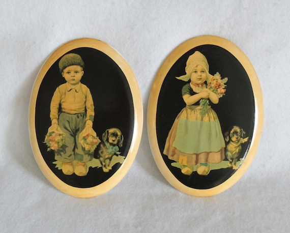 Pair Vintage Chalkware Dutch Boy And Girl Wall Plaque.. With Puppy & Flowers