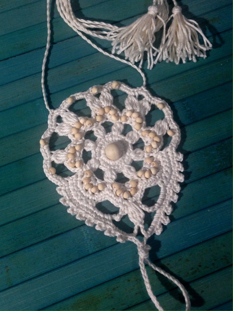 Crochet ivory yoga barefoot sandals boho with beads and tassels tied around the foot