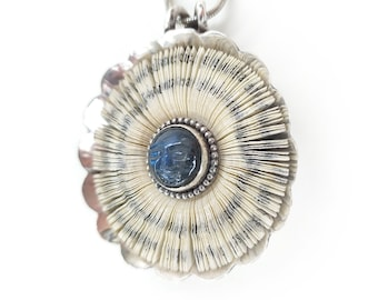Moonray halo pendant 48 mm - book pages in silver setting topped with carved blue moonstone face