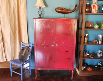 Wardrobe from the 1930's refinished with a black base with red distressed finish.