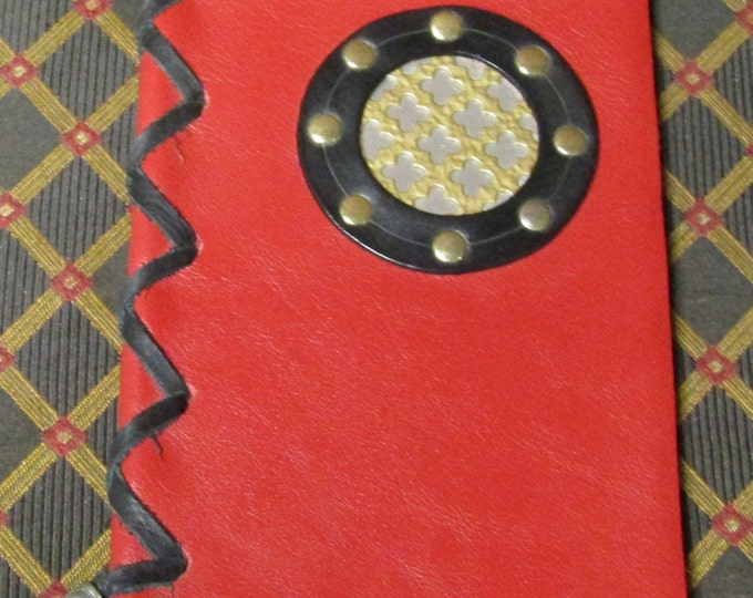 leather laced journal with a steampunk brass porthole design