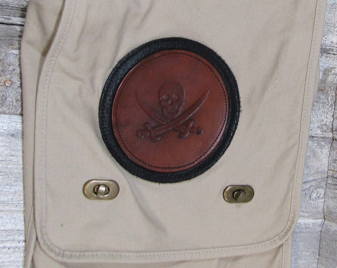 Canvas messenger bag with leather medallion pirate skull and crossed swords