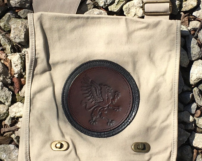 Canvas messenger bag with leather medallion rampant griffin gryphon