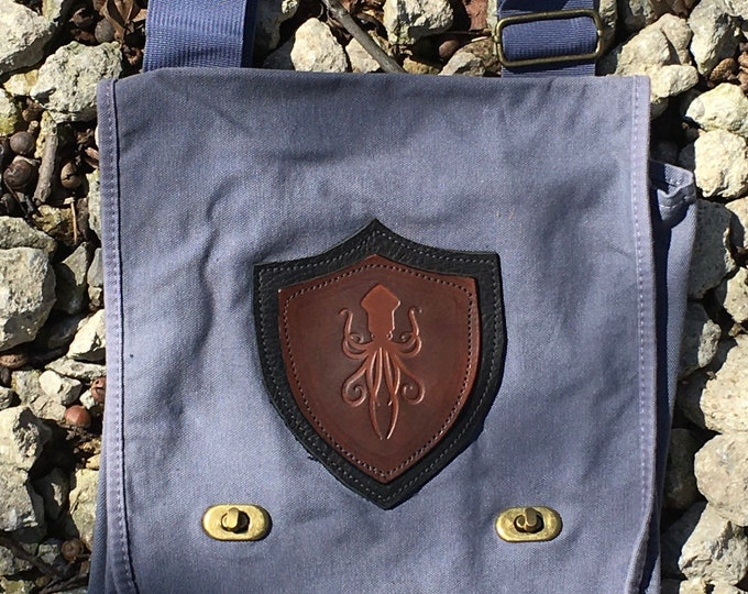 Canvas messenger bag with leather medallion squid octopus