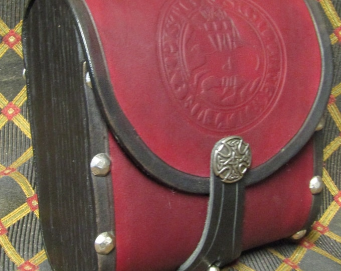 Leather and wood cartridge pouch with a Knights Templar seal