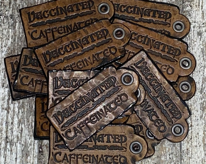Vaccinated / Caffeinated leather Faire pin necklace hang tag