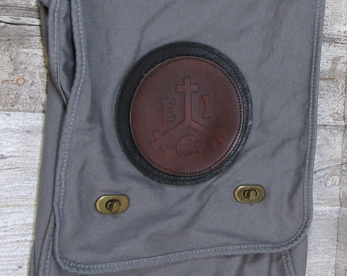 Canvas messenger bag with leather Medallion East India Trading Company logo