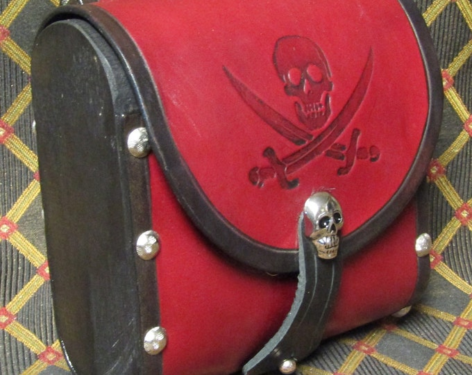 Leather and wood cartridge pouch with pirate skull and crossed swords design