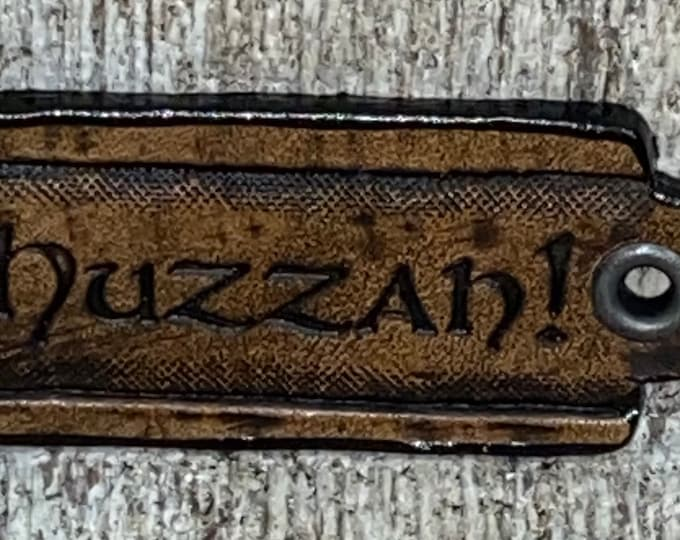 Huzzah! leather Faire pin necklace hang tag