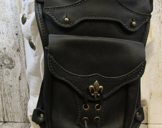 Leather hip / thigh bag, black brass fleur de lis