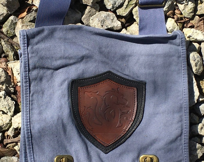 Canvas messenger bag with leather medallion hydra dragon