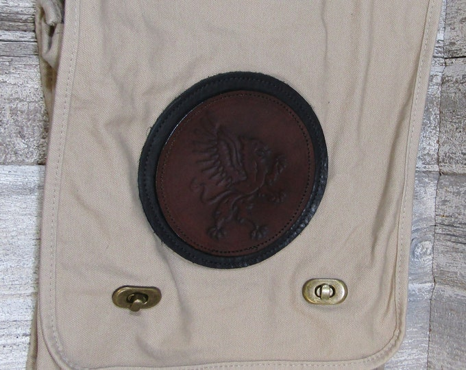 Canvas messenger bag with leather medallion heraldic griffin