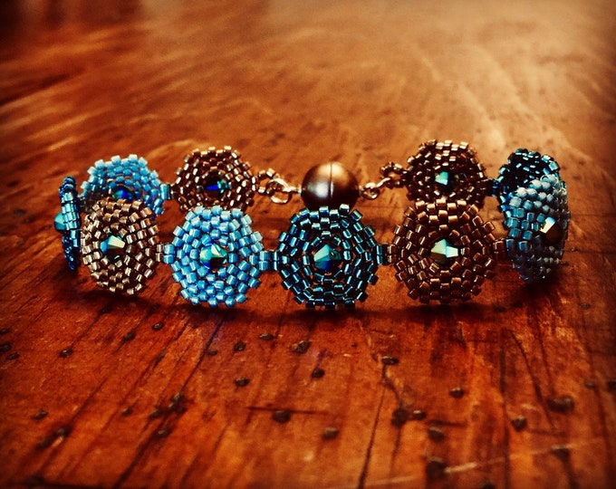 Featured listing image: Three tone hexagon beaded bracelet in bronze, teal and light blue!