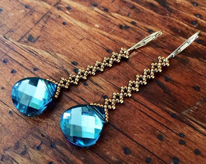 Featured listing image: Bronze & teal crystal teardrop earrings on a long beaded diamond chain