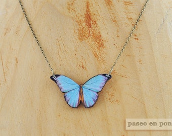 A clear blue butterfly necklace