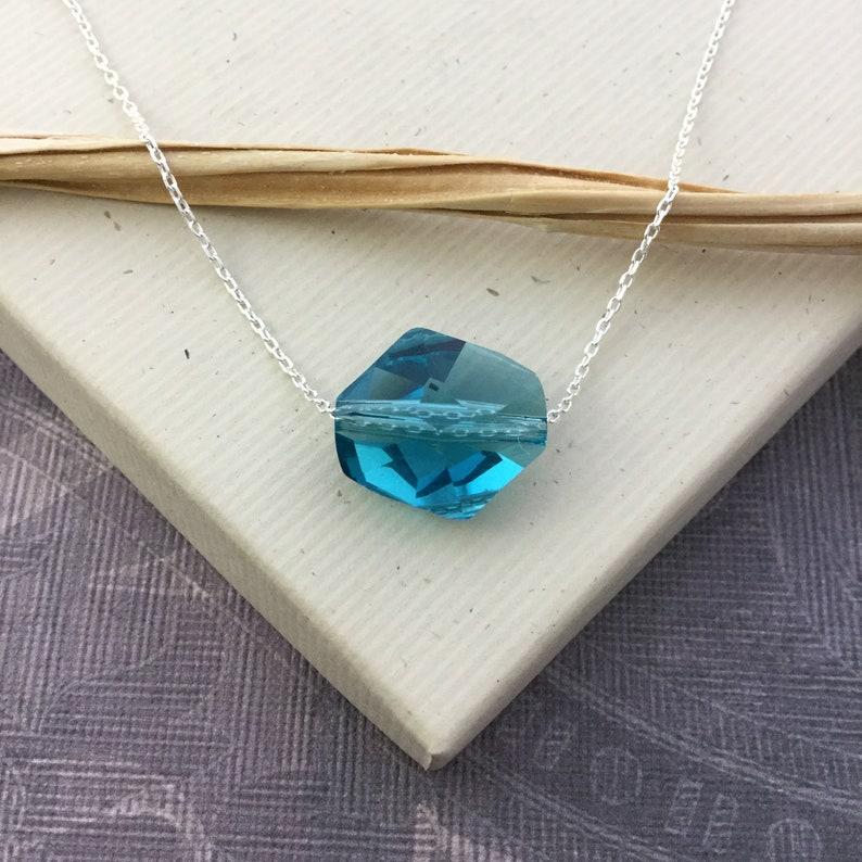 265d94cd5 Swarovski crystal faceted geometric cosmic crystal floating | Etsy