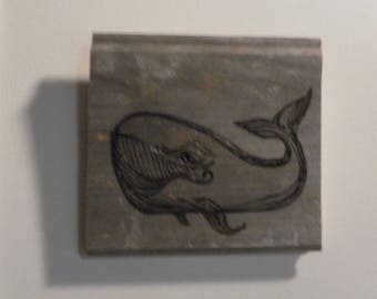 Pyrography Portrait of a smiling whale on weathered pine greyed on the sun on the beach-really-