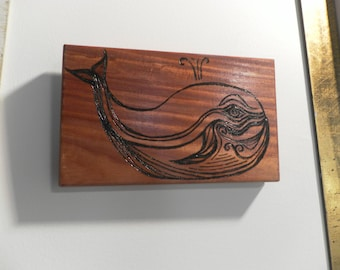 Pyrography Portrait of a Spouting whale on mahogany