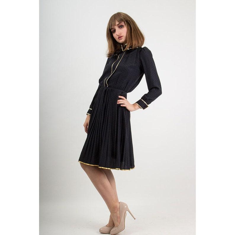 7f61faa974 NINA RICCI   1980s Vintage black silk jacquard pussy bow dress