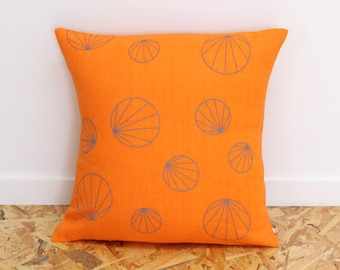 Geometric cushion cover in orange and grey