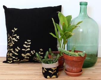 Black linen pillow cover with golden eucalyptus screenprint